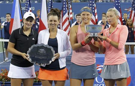 Andrea Hlavackova (R) and Lucie Hradecka of the Czech Republic pose with their winner's trophy as Ashleigh Barty (L) and Casey Dellacqua of Australia pose with their runner's up award after their women's doubles final match at the U.S. Open tennis championships in New York September 7, 2013. REUTERS/Eduardo Munoz