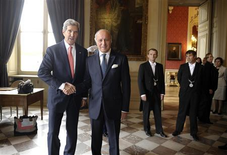 U.S. Secretary of State John Kerry (L) arrives for a meeting with French Foreign Affairs Minister Laurent Fabius (2nd L) at the Ministry of Foreign Affairs in Paris September 7, 2013. REUTERS/Susan Walsh/Pool