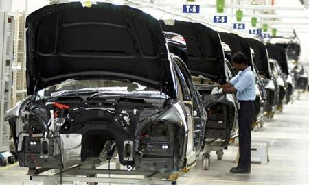 A worker assembles a car inside the newly opened BMW plant in Mahendra, about 50 km south from Chennai March 29, 2007. REUTERS/Babu/Files