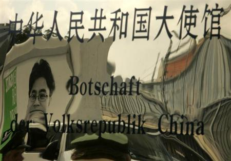 A picture of jailed Chinese journalist Shi Tao is reflected in the entrance sign of China's embassy in Berlin August 24, 2007. REUTERS/Tobias Schwarz
