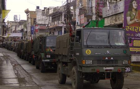 Indian army vehicles patrol on a deserted road during a curfew in Muzaffarnagar, in the northern Indian state of Uttar Pradesh September 8, 2013. REUTERS/Stringer