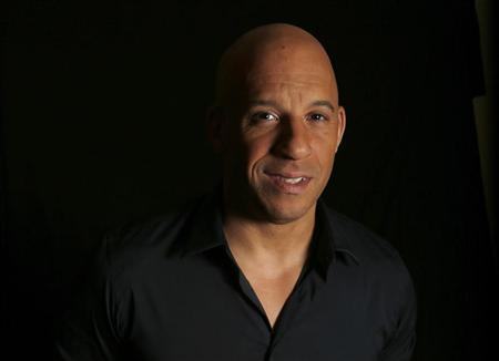 Actor Vin Diesel poses for a portrait while promoting his upcoming movie ''Riddick'' in Los Angeles, California August 27, 2013. REUTERS/Mario Anzuoni