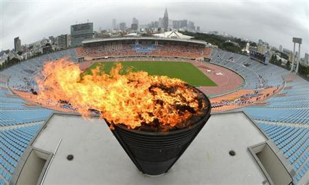 A flame relume on the Olympic cauldron, which was used the 1964 Tokyo Olympics, during an event celebrating Tokyo being chosen to host the 2020 Olympic Games, at the National Stadium in Tokyo, in this photo taken by Kyodo September 8, 2013. REUTERS/Kyodo
