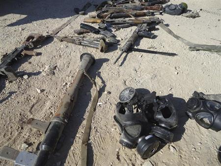 Weapons are seen in the sand near Adra, east of Damascus, in this handout photograph distributed by Syria's national news agency SANA August 7, 2013. REUTERS/SANA/Handout