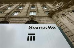 The logo of the world's second biggest reinsurer Swiss Re is seen in front of the company's headquarters in Zurich July 8, 2013. REUTERS/Arnd Wiegmann
