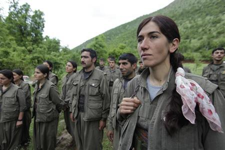 Kurdistan Workers Party (PKK) fighters stand in formation in northern Iraq May 14, 2013. REUTERS/Azad Lashkari