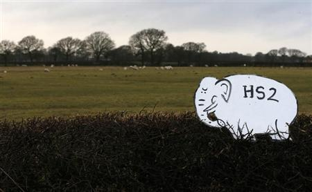 A placard in the shape of a white elephant, planted by an activist from the Midlands, stands on top of a hedge in a field near to the planned location of new HS2 high speed rail link as it passes by the village of Hoo Green, northern England January 28, 2013. REUTERS/Phil Noble