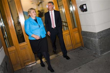 Norway's Prime Minister Jens Stoltenberg (R) and main opposition leader Erna Solberg leave a building after an appeareance on a television show in Oslo, September 8, 2013. REUTERS/Fredrik Varfjell/NTB Scanpix
