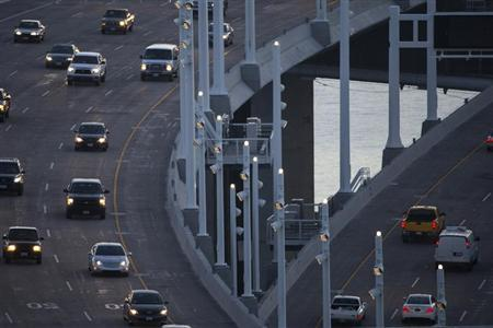 Motorists drive on the new eastern span of the San Francisco-Oakland Bay bridge during morning commute hours in San Francisco, California September 3, 2013. REUTERS/Stephen Lam