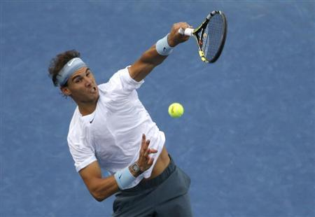 Rafael Nadal of Spain hits a smash to Richard Gasquet of France during their men's semi-final match at the U.S. Open tennis championships in New York September 7, 2013. REUTERS/Kena Betancur