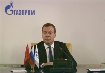 Russia's Prime Minister Dmitry Medvedev chairs a meeting as he visits the headquarters of the Gazprom company in Moscow, August 30, 2013. REUTERS/Dmitry Astakhov/RIA Novosti/Pool