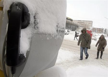 A public telephone booth is covered in snow in Kosovo's capital Pristina, January 26, 2012. REUTERS/Hazir Reka