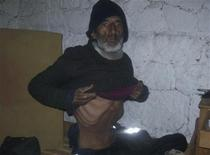 Uruguayan man Raul Fernando Gomez Circunegui, 58, shows his abdomen to rescuers in the shelter where he was found after disappearing four months ago in the remote Andes Mountains of San Juan Province, in this September 8, 2013 handout picture provided by the Government of San Juan Province. REUTERS/Government of San Juan Province/Handout via Reuters