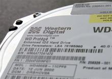 A Western Digital Corp's hard drive is seen at an electric appliance store in Tokyo, in this picture illustration taken March 8, 2011. REUTERS/Kim Kyung-Hoon