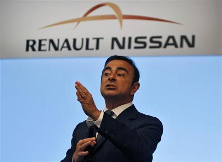 Carlos Ghosn, chairman and CEO of the Renault-Nissan Alliance, gestures as he speaks at a news conference in the southern Indian city of Chennai July 16, 2013. REUTERS/Babu