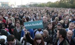 Митинг в поддержку Алексея Навального 9 сентября 2013 года. На выборах мэра Москвы накануне избирком отдал Сергею Собянину победу с минимальным перевесом. Навальный поражения не признал, потребовал пересчета голосов и второго тура. REUTERS/Tatyana Makeyeva
