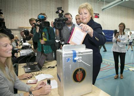 Erna Solberg, chairman of the Conservative Party of Norway, casts her vote during the general election at a polling station at Apeltun School in Bergen, September 9, 2013. REUTERS/Heiko Junge/NTB Scanpix
