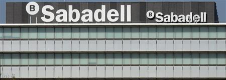 The logos of Banco Sabadell are seen on top of the company's headquarters in Sant Cugat, near Barcelona November 15, 2012. REUTERS/Albert Gea