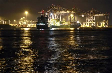 A container ship is docked at a port in Vallarpadam in the southern Indian city of Kochi September 4, 2013. REUTERS/Sivaram V