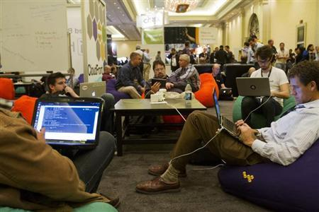 Developers and programmers participate in a coding challenge at the AWS Re:Invent conference at the Sands Expo in Las Vegas Nevada Nov. 28, 2012. REUTERS/Richard Brian