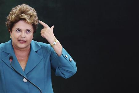 Brazil's President Dilma Rousseff speaks during a ceremony where she signs into law, the bill that allocates the country's oil royalties to education and health care, at the Planalto Palace in Brasilia September 9, 2013. REUTERS/Celso Junior