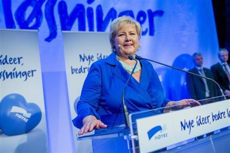 Norway's main opposition leader Erna Solberg of Hoyre speaks to party members while waiting for the results of the general elections in Oslo September 9, 2013. REUTERS/Stian Lysberg Solum/NTB Scanpix