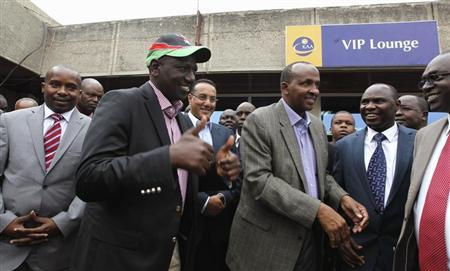 Kenya's Deputy President William Ruto (2nd L) bids farewell to government officials as he leaves Jomo Kenyatta airport in Nairobi, on his way to the International Criminal Court (ICC) at The Hague, September 9, 2013. REUTERS/Thomas Mukoya