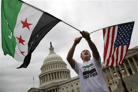 Jehad Sibai, a physician from Michigan, joins a group of Syrian-Americans rallying in favor of proposed U.S. military action, outside the U.S. Capitol in Washington, September 9, 2013. REUTERS/Jonathan Ernst