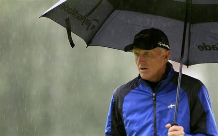 Greg Norman of Australia walks under an umbrella on the 15th green during the second round of the European Masters golf tournament in the Swiss mountain resort of Crans-Montana August 31, 2012. REUTERS/Arnd Wiegmann