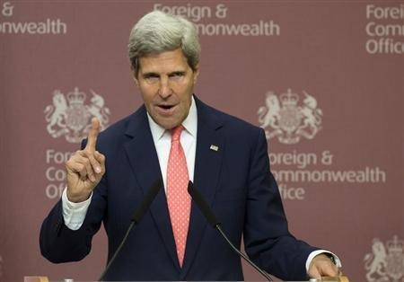 U.S. Secretary of State John Kerry gestures during his joint news conference with Britain's Foreign Secretary William Hague at the Foreign and Commonwealth Office in London September 9, 2013. REUTERS/Alastair Grant/pool