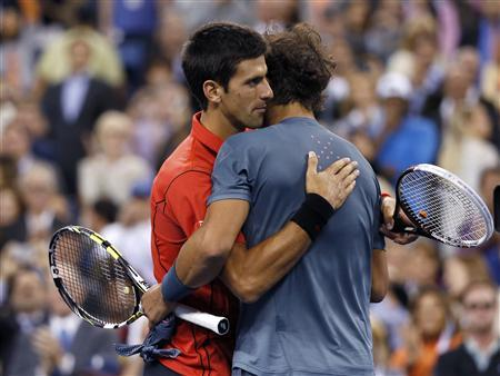 Rafael Nadal of Spain is congratulated by Novak Djokovic of Serbia (L) after his victory in their men's final match at the U.S. Open tennis championships in New York, September 9, 2013. REUTERS/Mike Segar