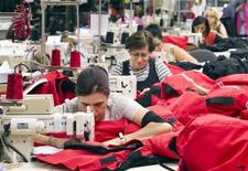 Workers piece together outerwear on the manufacturing floor of Canada Goose's facility in Toronto January 17, 2012. REUTERS/Fred Thornhill