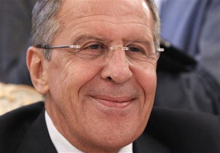 Russia's Foreign Minister Sergei Lavrov smiles during a meeting with his Libyan counterpart Mohammed Abdulaziz in Moscow, September 10, 2013. REUTERS/Maxim Shemetov