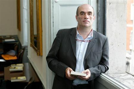 Irish author Colm Toibin poses for photographers after he won the world's richest literary prize for a single work of fiction in English on Tuesday for ''The Master'' in Dublin, Ireland June 13, 2006.