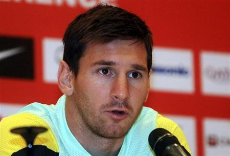 Barcelona's Lionel Messi speaks during a news conference ahead of the team's friendly soccer match against Malaysia XI on Saturday, in Petaling Jaya outside Kuala Lumpur August 8, 2013. REUTERS/Stringer