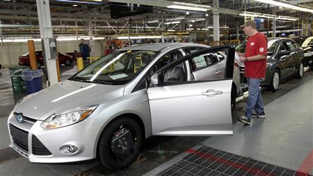 A Ford Motor assembly worker inspects the new 2012 Ford Focus vehicles on the final production line at Michigan Assembly Plant in Wayne, Michigan March 17, 2011. REUTERS/Rebecca Cook