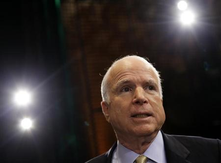 U.S. Senator John McCain (R-AZ) speaks to reporters after attending a ''Conversation On Immigration'' during a town hall event in Mesa, Arizona August 27, 2013. REUTERS/Joshua Lott