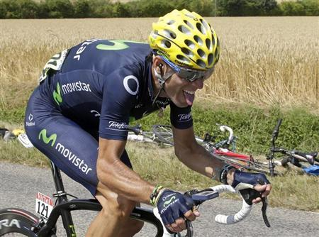 Movistar team rider Alejandro Valverde of Spain cycles during the 173 km thirteenth stage of the centenary Tour de France cycling race from Tours to Saint-Amand-Montrond July 12, 2013. REUTERS/Jacky Naegelen