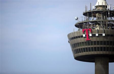 The logo of Deutsche Telekom is pictured on the 266 metre high ''Colonia'' TV tower in the western German city of Cologne March 25, 2013. REUTERS/Wolfgang Rattay