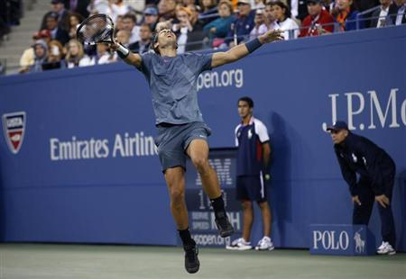Rafael Nadal of Spain celebrates after defeating Novak Djokovic of Serbia in their men's final match at the U.S. Open tennis championships in New York, September 9, 2013. REUTERS/Mike Segar