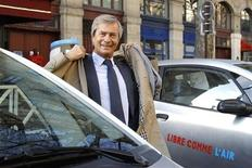 Vincent Bollore, CEO of investment group Bollore, stands by Autolib' electric cars during the inauguration of the the Autolib' service in Paris December 5, 2011. REUTERS/Benoit Tessier