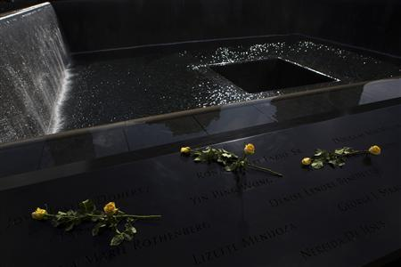 Roses are seen at the north pool of the 9/11 Memorial in New York September 9, 2013. REUTERS/Eric Thayer
