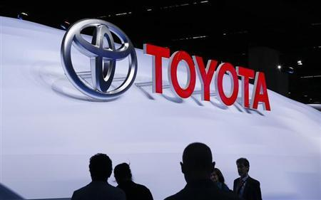 A Toyota emblem is pictured at the company's stand during a media preview day at the Frankfurt Motor Show (IAA) September 10, 2013. REUTERS/Wolfgang Rattay