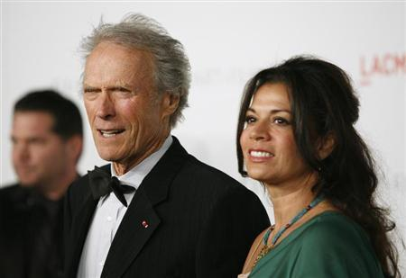 Honoree, actor and director Clint Eastwood (L) and wife Dina Eastwood arrive at the Los Angeles County Museum of Art (LACMA) Art + Film Gala in Los Angeles, California in this November 5, 2011 file photo. REUTERS/Jason Redmond