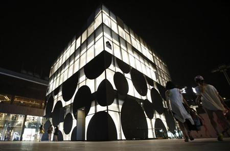 Luxury brands shops are seen at a shopping complex in Sanlitun in Beijing July 16, 2013. REUTERS/Kim Kyung-Hoon