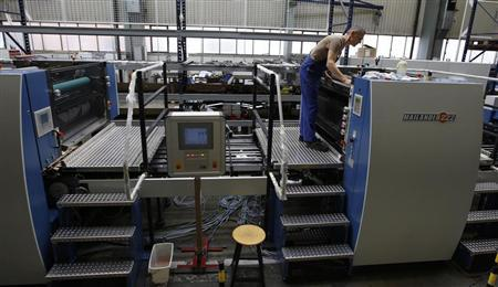 An employee controls a part of the 'Mailaender222' machine in Stuttgart July 20, 2012. REUTERS/Michaela Rehle
