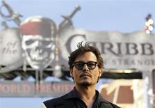 "Cast member Johnny Depp poses at the premiere of ""Pirates of the Caribbean: On Stranger Tides"" at Disneyland in Anaheim, California May 7, 2011. REUTERS/Mario Anzuoni"