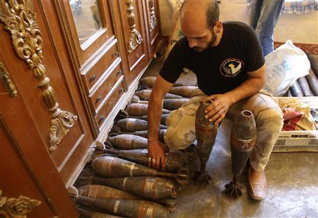 A Free Syrian Army handles homemade mortar shells inside a house in the old city of Aleppo September 10, 2013. REUTERS/Molhem Barakat