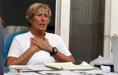 U.S. long-distance swimmer Diana Nyad finishes a conference call with a group of fellow endurance swimmers to answer skeptics about her record-breaking crossing of the Florida Straits last week, in Huntington Beach, California September 10, 2013. REUTERS/Alex Gallardo