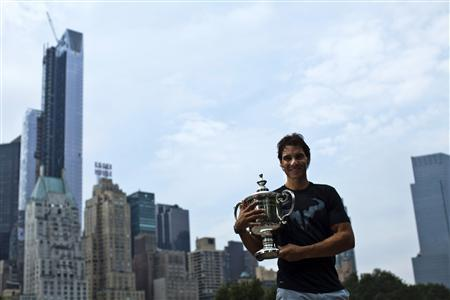 Rafael Nadal of Spain poses with his trophy after winning the men's singles final match against Novak Djokovic of Serbia at the U.S. Open tennis tournament in New York's Central Park, September 10, 2013. REUTERS/Eduardo Munoz